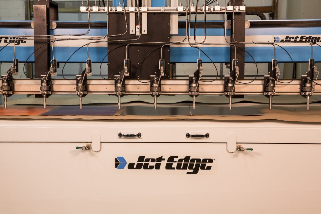 Jet edge water jet cutting system